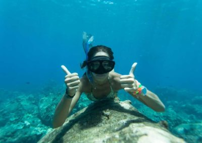 female_snorkeler_thumbs_up